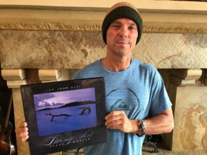 Kenny Chesney with his personally signed copy of Living Art