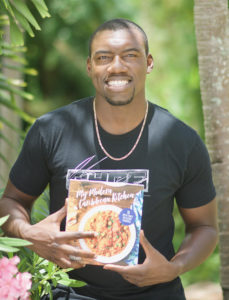 Julius Jackson with Cookbook My Modern Caribbean Kitchen Book about Food on St. Thomas
